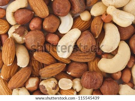 background of mixed nuts - hazelnuts, walnuts, almonds, pine nuts - stock photo