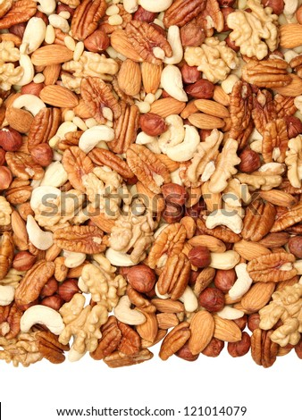 background of mixed nuts - pecans, hazelnuts, walnuts, cashews, almonds, pine nuts, pistachios, isolated from the bottom, the size of 4 to 3 - stock photo