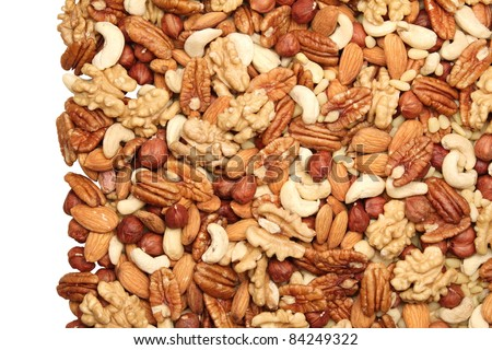 Background of mixed nuts - pecans, hazelnuts, walnuts, cashews, almonds, pine nuts, pistachios, Isolated one edge. - stock photo