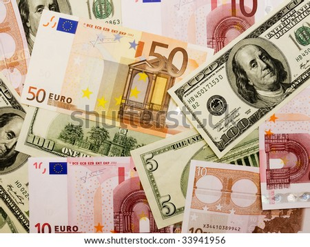Background of money with euro and dollars - stock photo