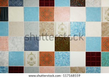 background of motley wall tiles, mixed up all in a tumble - stock photo