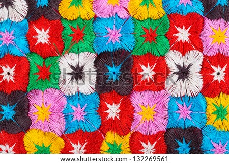 background of multi-colored embroidered flowers - stock photo