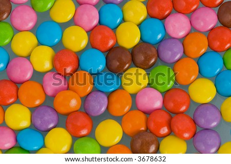Background of multi colored smarties candy - stock photo