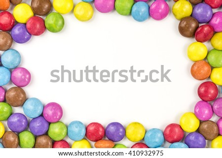 background of multicolored sugar coated candies with copy space - stock photo