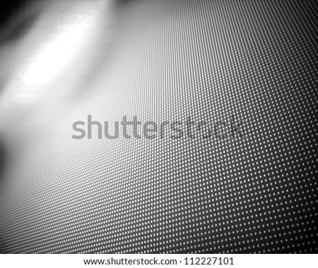 Background of multiple grey dots fading to white - stock photo