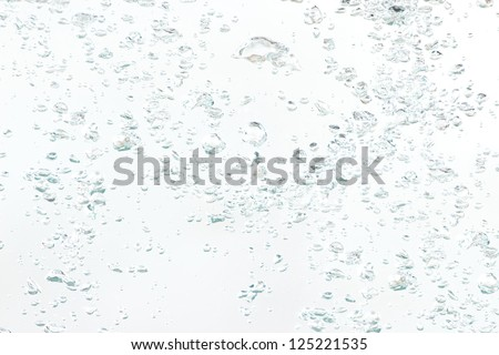 Background of natural air bubbles in the water on a white background - stock photo