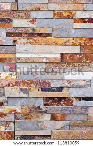 background of natural slate stone veneer wall