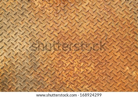 Background of old and grungy metal diamond plate - stock photo