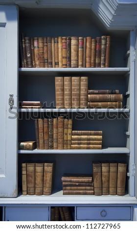 background of old books on shelf - stock photo
