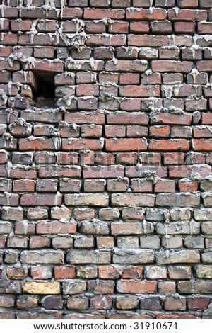 Background of old brick wall with little hole - stock photo