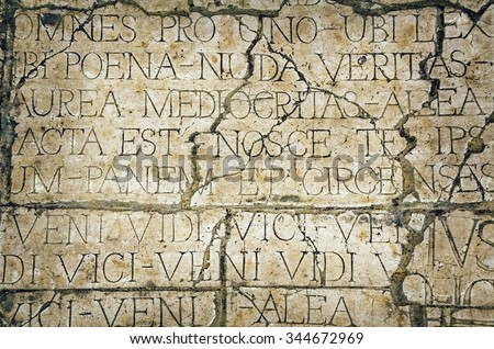 Background of Old Cracked Wall  with Latin Inscriptions  - stock photo