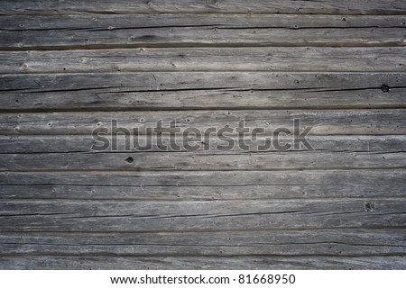 Background of old gray weathered knotted wooden wall - stock photo