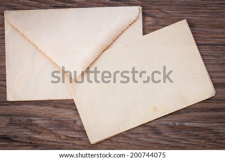 Background of old letters, postcards, photographs and memories, on dark wood - stock photo