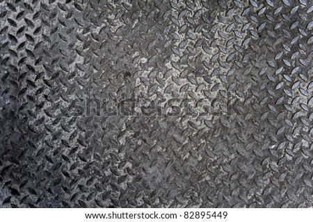 Background of old metal diamond plate in grey color - stock photo