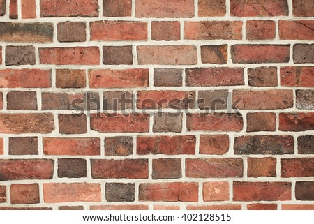 Background of old vintage accurate brick wall - stock photo