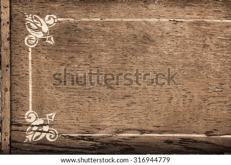 background of old wood with scratches and cracks with white frame ornament