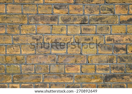 Background of old yellow brick wall - stock photo