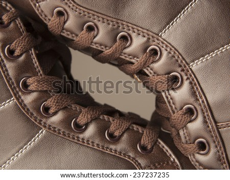 Background of pair or couple Close up view of brown leather man or woman new dry clean shoes, showing laces in detail.Texture backdrop Unisex style - stock photo