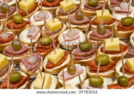 Background of party appetizers on wooden sticks - stock photo