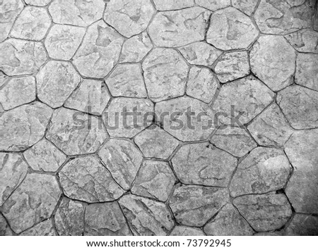 Background of paving tiles of natural rock - stock photo