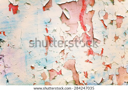 Background of peeling paint on an old wall