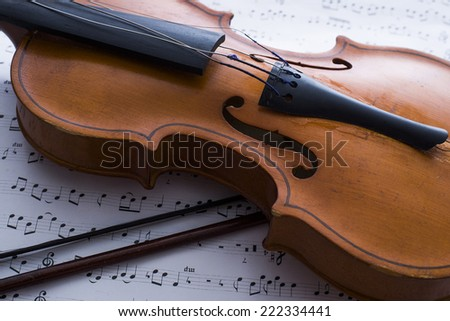 Background of  Photo Of Violin bow And Musical Notes on white paper Close-up horizontal format  - stock photo