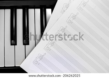 background of piano keyboard with notes - stock photo