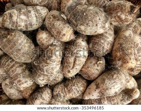 background of pile of fresh organic taro for retail sale in local morning market departmental store - stock photo