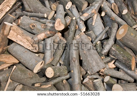 Background of piled firewood logs - stock photo