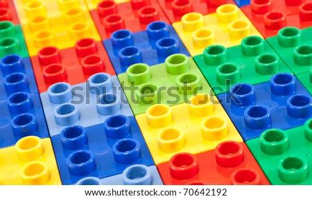 Background of plastic building blocks.  Bright colors. - stock photo