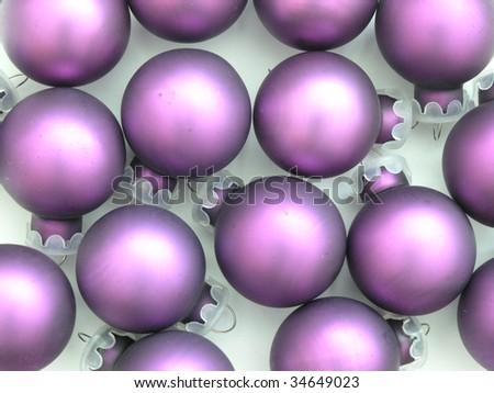 background of purple Christmas tree ornaments - stock photo