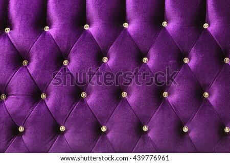 Background of purple Velvet / fabric modern sofa in close up. - stock photo