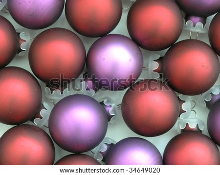background of red and purple Christmas tree ornaments - stock photo