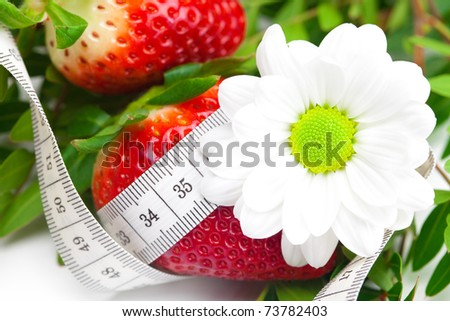 background of red big juicy ripe strawberry and flower - stock photo