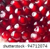 Background of red  pomegranate seeds. - stock photo