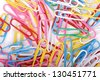 Background of red, yellow, blue, pink and white clips/Paper clip - stock photo