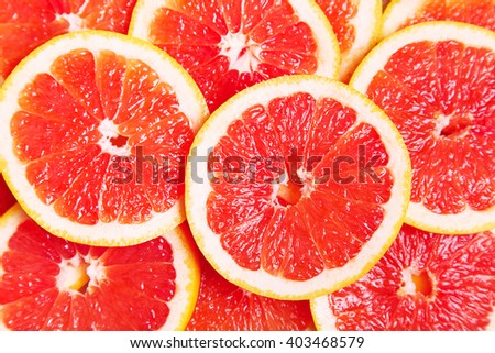 Background of ripe juicy grapefruit slices, healthy food - stock photo