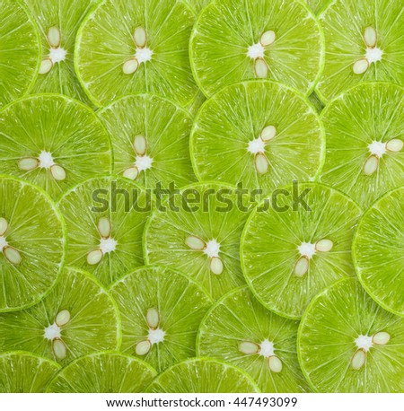 Background of ripe lime slices - stock photo