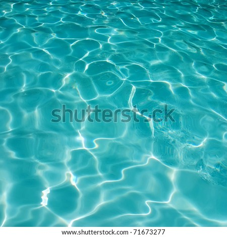 Background of rippled pattern of clean water in a blue swimming pool - stock photo
