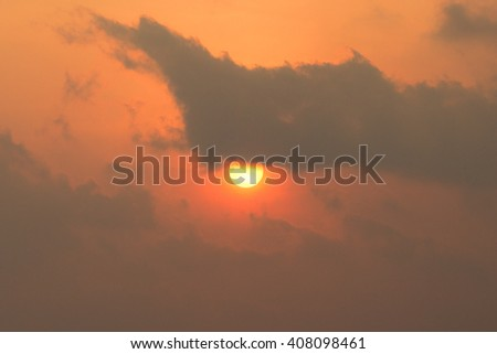 Background of rising sun behind cloudy. - stock photo
