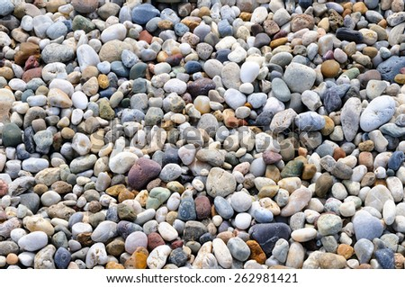background of round colored sea pebbles, close-up - stock photo