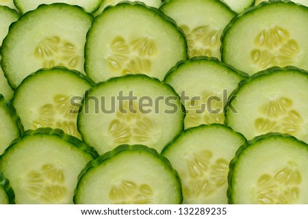 Background of rows of juicy cucumber slices - stock photo