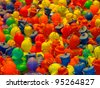 Background of rubber ducks fishing game on an arcade - stock photo