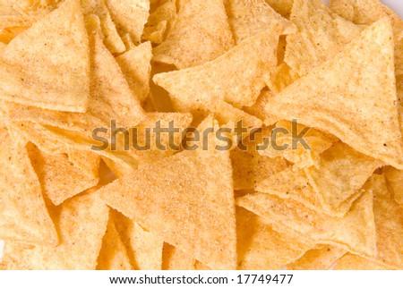 Background of salty yellow nachos - stock photo