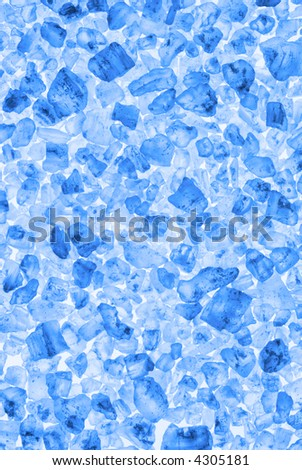 Background of sea salt crystals, toned blue.