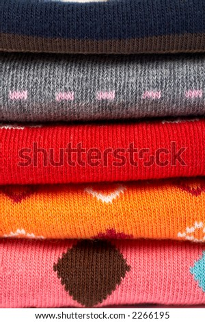 Background of several colors clothes stack