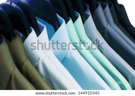 background of shirts hanging on a hanger - stock photo
