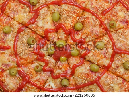 Background of Sliced Pizza with Ham, Bacon, Cheese, Green Olives filled with Paprika, Sesame, Garlic and Tomato Sauce, Closeup shot from above - stock photo