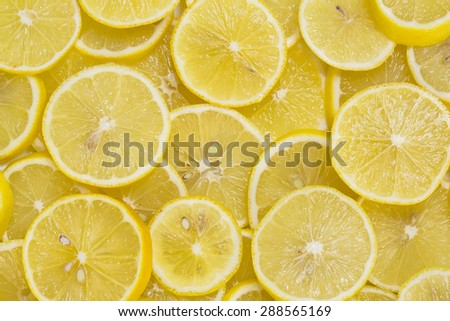 background of sliced ripe lemons organic, pattern - stock photo