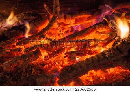 Background of smoldering wood in a fireplace closeup - stock photo